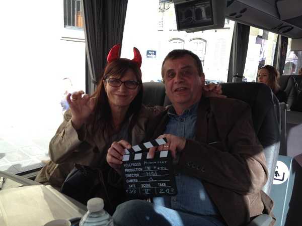 movies in Paris Jacqueline and Michel with props for group photo