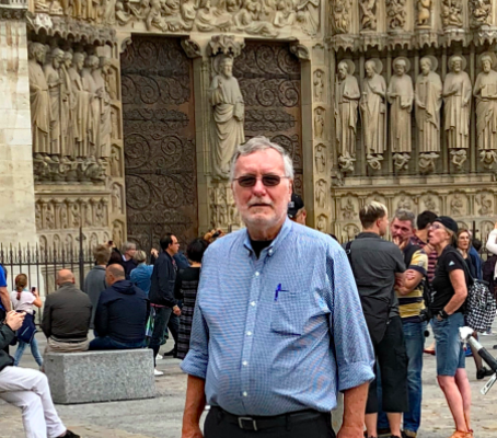David Collins: in front of Notre Dame. I love the darkness inside and it's still one of my favorite places in Paris. A friend who was in Paris at the time of the fire sent me photos a few days afterwards. I'm still stricken.